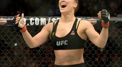 Ronda Rousey (red gloves) reacts after defeating Cat Zingano (not pictured) during their women's bantamweight title bout at UFC 184 at Staples Center. Rousey won in 14 seconds of the first round. Mandatory Credit: Jayne Kamin-Oncea-USA TODAY Sports