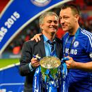 Chelsea manager Jose Mourinho with his captain John Terry after their League Cup victory over Tottenham Hotspur. Photo: GLYN KIRK/AFP/Getty Images