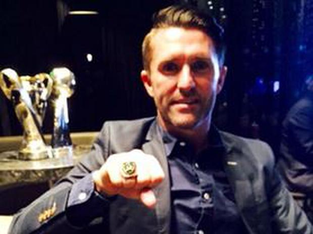 Robbie Keane shows off his MLS championship ring