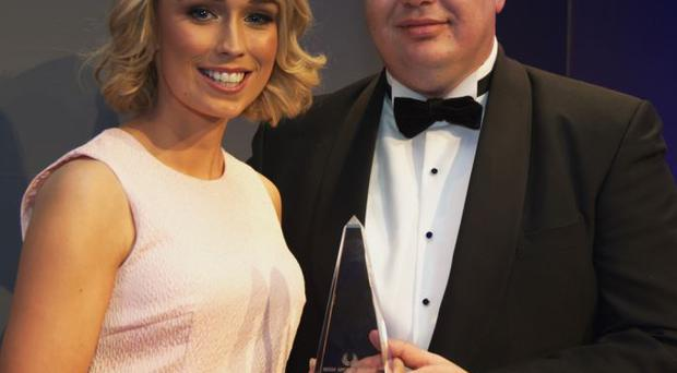 Patrick Magee, Country Operations Manager for Renault Group Ireland, presents Stephanie Roche with her award
