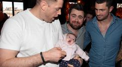 Jamie Heaslip with baby Serena Swan (6 Weeks old), her father Alan Swan and Rob Kearney