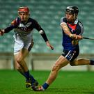 Jake Dillon, WIT, in action against Gearoid Ryan, UL