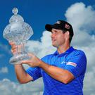 Padraig Harrington lifts his Honda Classic trophy aloft after his first PGA Tour win in seven years