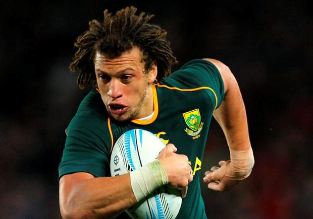 AUCKLAND, NEW ZEALAND - SEPTEMBER 14: Zane Kirchner of South Africa makes a run during The Rugby Championship match between the New Zealand All Blacks and the South African Springboks at Eden Park on September 14, 2013 in Auckland, New Zealand. (Photo by Anthony Au-Yeung/Getty Images)