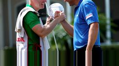 Padraig Harrington celebrates his Honda Classic win with his caddie Ronan Flood (left)