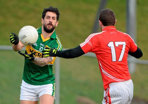Paul Galvin, Kerry, in action against John Hayes, Cork