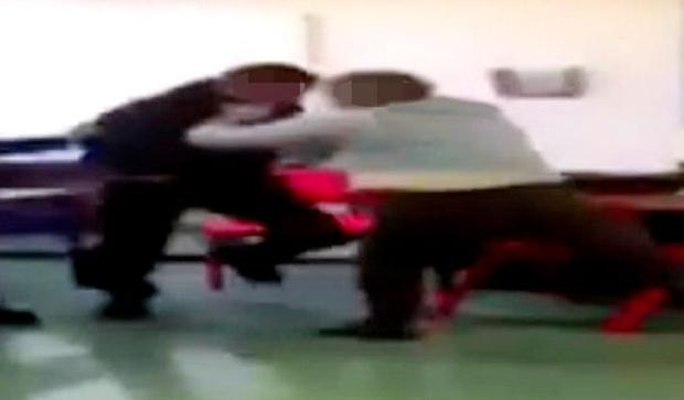 INVESTIGATION: The teacher is seen in the video grappling with the teen before 'body-slamming' him to the classroom floor