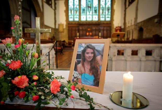 A candle burns besides a photograph of Becky Watts at St Ambrose Church, as her stepbrother Nathan Matthews was been charged with her murder. Photo: Matt Cardy/Getty Images