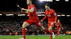 Jordan Henderson celebrates after opening the scoring at Anfield alongside Liverpool team-mate Adam Lallana