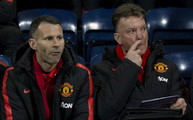 Divided? Ryan GIggs and Louis van Gaal might not be seeing eye to eye over Manchester United's tactics Photo: AP