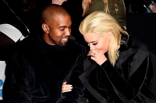 Kim Kardashian and Kanye West attend the Balmain show as part of the Paris Fashion Week Womenswear Fall/Winter 2015/2016 on March 5, 2015 in Paris, France. (Photo by Pascal Le Segretain/Getty Images)