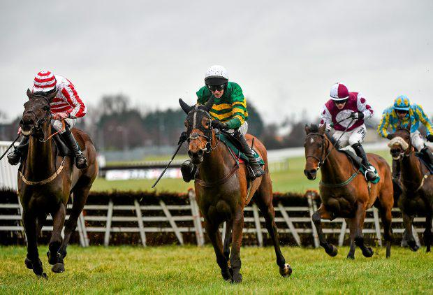 A Hardy Nailer, with Mark Walsh up, centre frame, leads eventual winner Arctic Skipper, with Andrew Lynch up, left, in the Paddy Power Shops 10.30am Sunday Service Maiden Hurdle