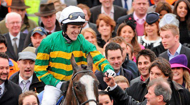 Jockey Tony McCoy, aboard Synchronised, celebrates with owner JP McManus after winning the Betfred Cheltenham Gold Cup Steeple Chase. Cheltenham Racing Festival, Prestbury Park, Cheltenham, England. Picture credit: Brendan Moran / SPORTSFILE