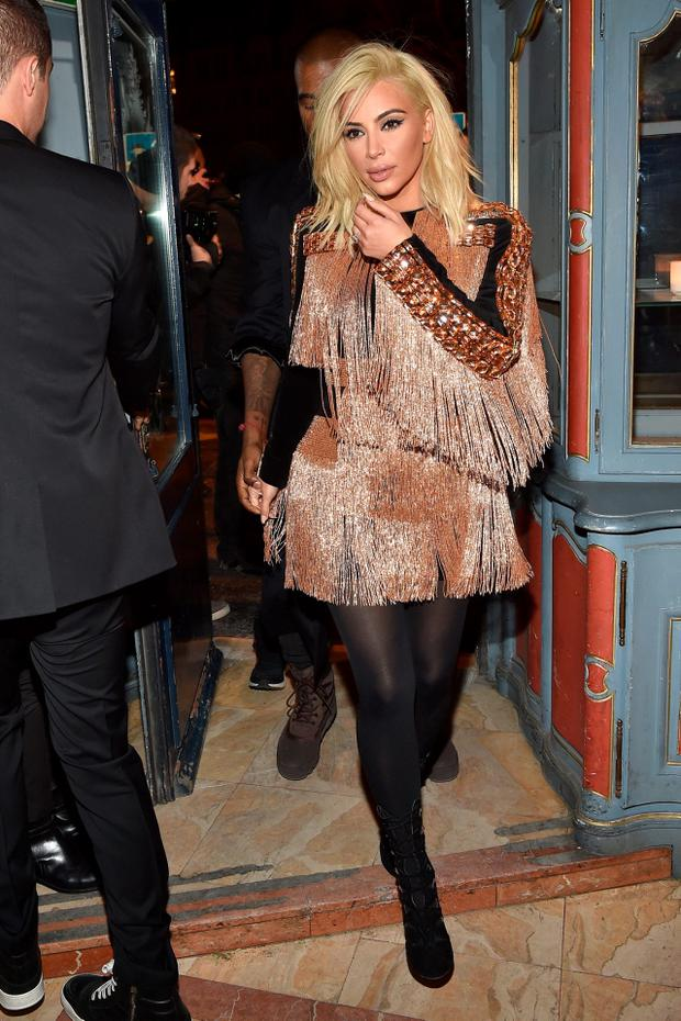 Kim Kardashian attends the Balmain Aftershow Dinner as part of the Paris Fashion Week Womenswear Fall/Winter 2015/2016