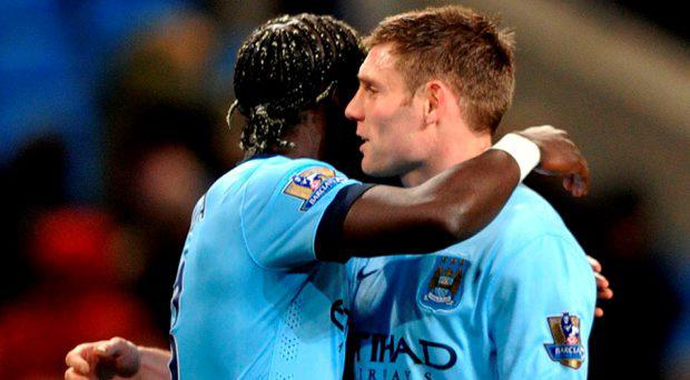 Manchester City's French defender Bacary Sagna and Manchester City's English midfielder James Milner (R)