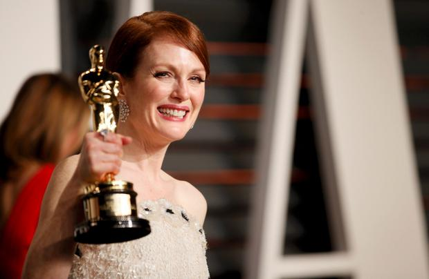 Actress Julianne Moore with her Best Actress award for her role in the film