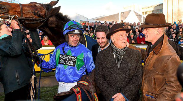 Hurricane Fly with jockey Ruby Walsh, trainer Willie Mullins, right, groom Gail Carlisle, and owner George Creighton, after winning the Ryanair Hurdle