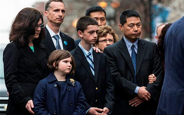 (L-R) Denise Richard, Bill Richard, Jane Richard and Henry Richard, the family of Martin Richard, an eight-year-old boy killed by a bomb at the Boston marathon