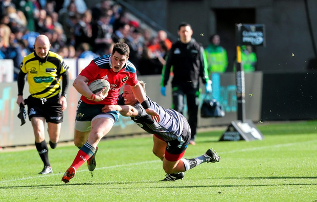 Munster's Ronan O'Mahony is tackled by Hanno Dirksen, Ospreys.