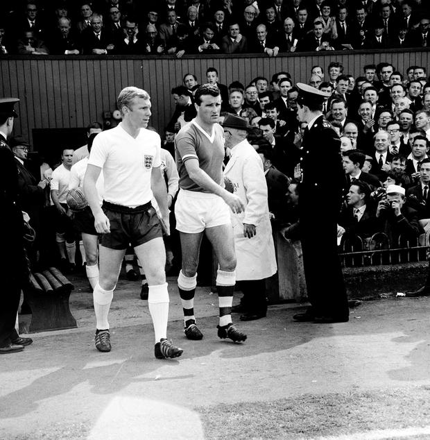 Republic of Ireland captain Noel Cantwell and England captain Bobby Moore lead their respective side's out ahead of a friendly between the Republic of Ireland and England, Dalymount Park, Dublin. Picture credit; Connolly Collection / SPORTSFILE