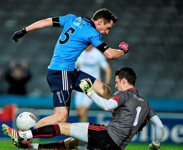 Nicky Devereux has a shot blocked by Tyrone's Niall Morgan