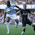 Tottenham's Harry Kane in action with QPR's Nedum Onuoha