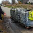 TOXIC: Reporter Jim Cusack with 'cubes' of waste from fuel laundering