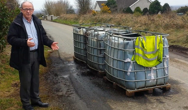 TOXIC: Jim Cusack with 'cubes' of waste at Captain's Road