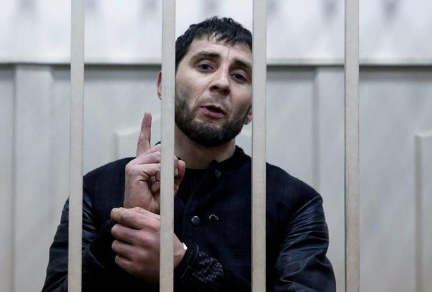 Zaur Dadayev looks on defiantly at reporters from inside a defendants' cage as he faced charges of the murder of Russian opposition figure Boris Nemtsov. Photo: REUTERS/Tatyana Makeyeva