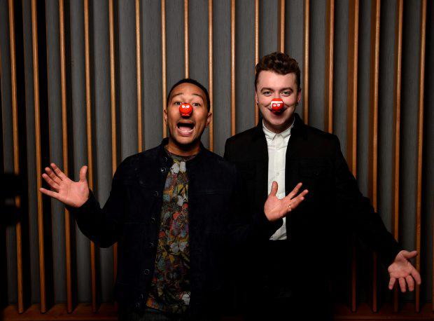 Undated handout photo issued by Comic Relief of Sam Smith (right) and John Legend as they have recorded a special version of Sam's single Lay Me Down with for Comic Relief