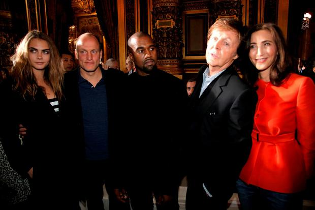 From left, model Cara Delevingne, actor Woody Harrelson, singers Kanye West and Paul McCartney along with wife Nancy Shevell pose for photographers prior to Stella McCartney's ready to wear fall-winter 2015-2016 fashion collection during Paris Fashion Week