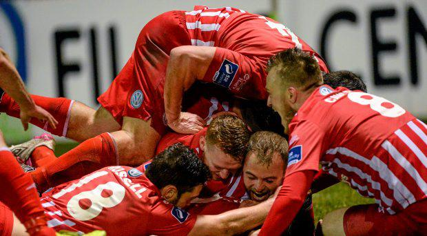Sligo Rovers players on top of Stephen Beattie after scoring his side's goal