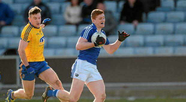 Evan O'Carroll, Laois, in action against Neil Collins, Roscommon