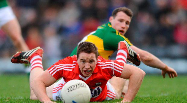 Colm O'Neill, Cork, in action against Mark Griffin, Kerry