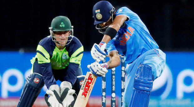 India's Virat Kohli (R) plays a shot against Ireland, as Gary Wilson watches, during their Cricket World Cup match in Hamilton March 10, 2015
