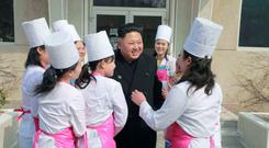 North Korean leader Kim Jong Un smiles during his inspection of Unit 1016 of KPA (Korean People's Army) Air and Anti-Air Force honored with the Title of O Jung Hup-led 7th Regiment, in this undated photo released by North Korea's Korean Central News Agency (KCNA) in Pyongyang March 9, 2015