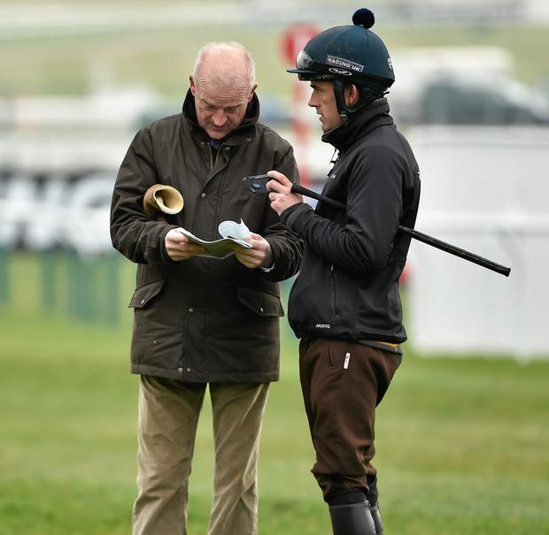 Willie Mullins and Ruby Walsh make their way back from the gallops ahead of the Cheltenham Racing Festival 2015