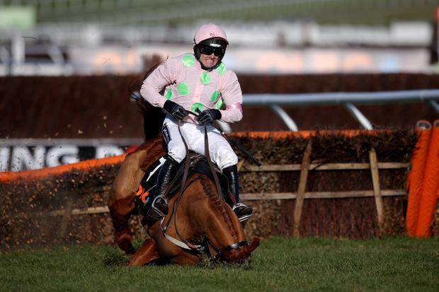 CHELTENHAM, ENGLAND - MARCH 10: Ruby Walsh falls from Annie Power at the last when clear in The OLBG Mare' Hurdle Race at Cheltenham racecourse on March 10, 2015 in Cheltenham, England. (Photo by Alan Crowhurst/Getty Images)