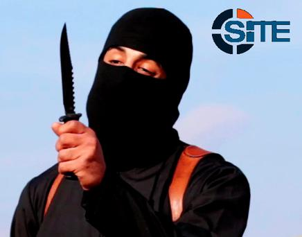 Mohammed Emwazi, brandishes a knife in this still image from a 2014 video (Reuters)