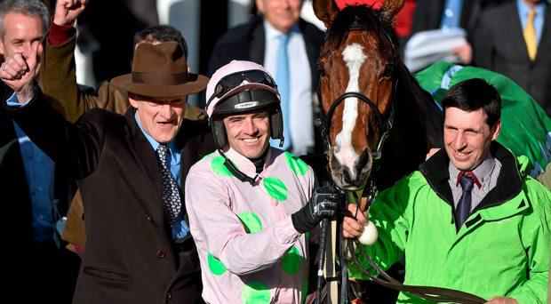 Jockey Ruby Walsh and trainer Willie Mullins celebrate in the winner's enclosure after victory in the Champion Hurdle with Faugheen