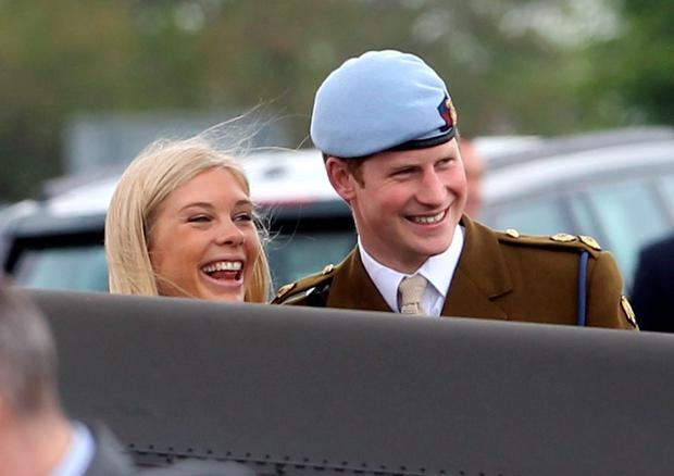 Prince Harry and Chelsy Davy laugh as they attend Prince Harry's Pilot Course Graduation at the Army Aviation Centre on May 7, 2010