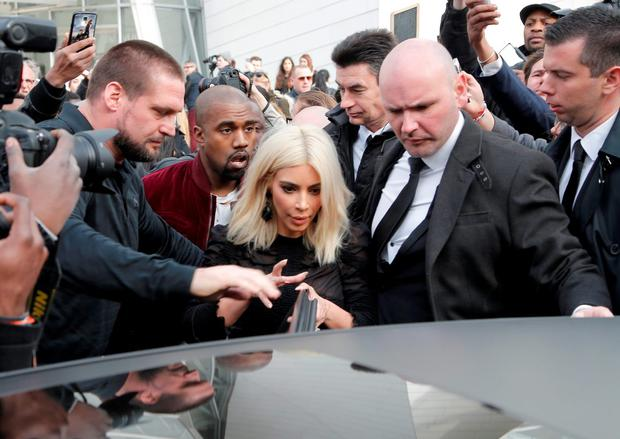 Kim Kardashian and singer Kanye West leave Louis Vuitton's Fall-Winter ready-to-wear fashion collection presented during the Paris Fashion Week