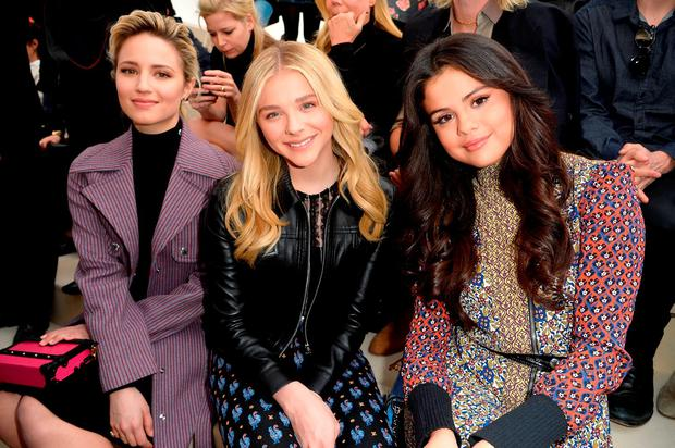 (L-R) Dianna Agron, Chloe Moretz and Selena Gomez attend the Louis Vuitton show as part of the Paris Fashion Week Womenswear Fall/Winter 2015/2016