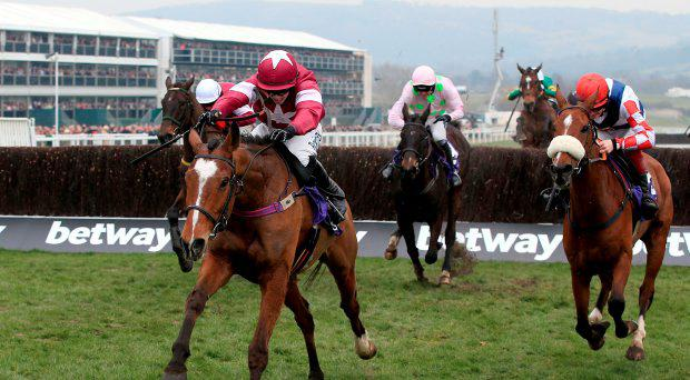 Don Poli ridden by Bryan Cooper (left) races clear of the field before going on to win in the RSA Chase on Ladies Day during the Cheltenham Festival at Cheltenham Racecourse