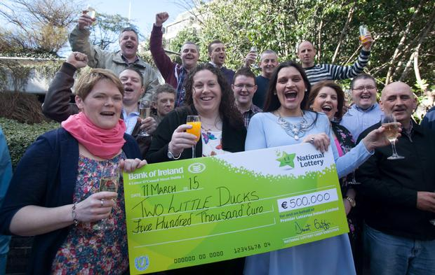 Pharmaceutical workers from Glaxosmith Kline Dungarvan, Co. Waterford celebrate their 500,000 Euromillions plus prize at National Lottery Offices, Dublin. Photo: Gareth Chaney Collins