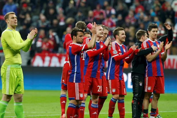 Bayern Munich's players applaud their supporters after their Champions League Round of 16 second leg soccer match against Shakhtar Donetsk