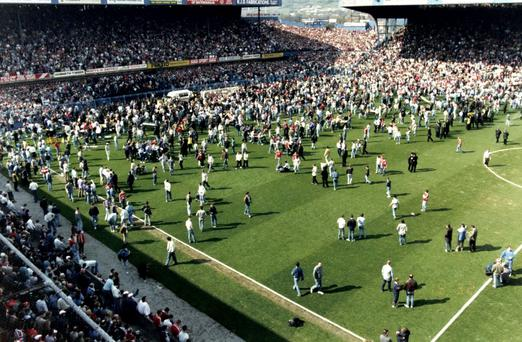 Shocked fans on the pitch after the Hillsborough disaster in 1989