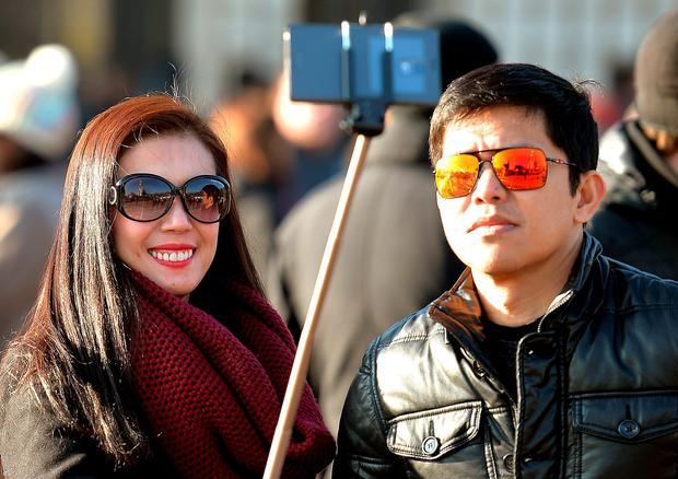 Selfie sticks. Picture posed