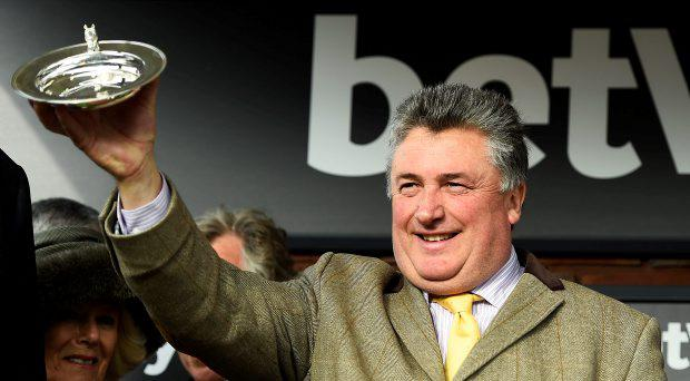 Paul Nicholls, the trainer of Dodging Bullets celebrates winning the 15.20 Betway Queen Mother Champion Steeple Chase