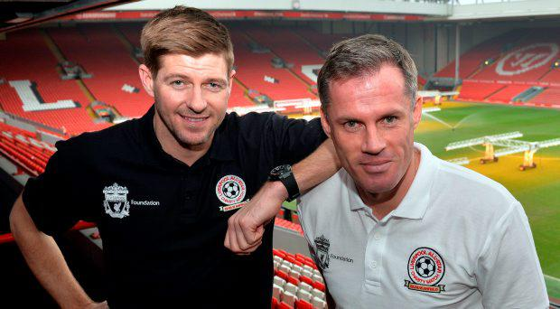Liverpool's English captain and midfielder Steven Gerrard (L) and former Liverpool team mate Jamie Carragher
